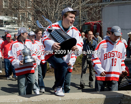 Mike Geragosian (BU - Volunteer Assistant Coach), Jason Lawrence (BU - 21), Chris Connolly (BU - 12), Victor Saponari (BU - 17), Chris Higgins (BU - 10), Brandon Yip (BU - 18) - Boston University celebrated the Terrier's men's hockey national championship win with a parade starting from a parking lot at Commonwealth Avenue and Deerfield running to BU's Marsh Plaza where the Terriers were honored on stage before mingling with the fans.