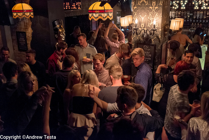 UK.Cleethorpes . 20th October 2013<br /> punters in a bar in cleethorpes.<br /> &copy;Andrew Testa for the Sunday Times Magazine