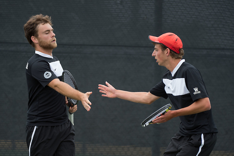 April 22, 2015; San Diego, CA, USA; Santa Clara Broncos tennis players Michael Standifer (left) and Max Heerinckx (right) during the WCC Tennis Championships at Barnes Tennis Center.