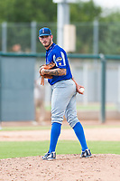 Team Italy relief pitcher Claudio Scotti (44) checks the runner at first base during an exhibition game against the Oakland Athletics at Lew Wolff Training Complex on October 3, 2018 in Mesa, Arizona. (Zachary Lucy/Four Seam Images)