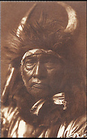 BNPS.co.uk (01202 558833)<br /> Pic: Bloomsbury/BNPS<br /> <br /> Bull Chief from the Apsaroke tribe in 1908.<br /> <br /> Lost souls - Poignant archive reveals the lost tribes of North America in beautiful photographs from just over a century ago.<br /> <br /> A remarkable collection of photographs which give an unprecedented insight into the lives of Native Americans at a time when their land was being taken from them have emerged at auction.<br /> <br /> Between 1907 and 1930, US photographer Edward Curtis spent time with more than 80 native tribes across Native America, taking thousands of photographs as part of his groundbreaking The North American Indian project.<br /> <br /> A collection of more than 500 rare Curtis photographs are being auctioned off later this month and are expected to fetch over &pound;300,000.