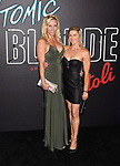 LOS ANGELES, CA - JULY 24:  Fitness personality Lisa Paul Newman (L) and actress/stuntwoman Heidi Moneymaker arrive at the Premiere Of Focus Features' 'Atomic Blonde' at The Theatre at Ace Hotel on July 24, 2017 in Los Angeles, California.