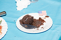 A chocolate cupcake decorated with the American flag lays on a table at the Milford Democrats' Potluck Supper at the Unitarian Universalist Congregation Church in Milford, New Hampshire, USA, on Sat., Apr. 6, 2019. Democratic presidential candidate and Congressional Representative Eric Swalwell (D-CA 15th) spoke at the event. Swalwell is running primarily on gun control issues.