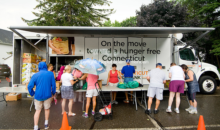 WATERTOWN, CT-080217JS06-- Local residents visit the Connecticut Food Bank Mobile Pantry Wednesday at the First Congressional Church in Watertown. The pantry, which comes to the church the first Wednesday of every month, provides fresh food to all. <br />  Jim Shannon Republican-American