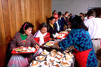 Hmong family being served Christmas dinner at church soup kitchen age 45 and 70.  Minneapolis Minnesota USA