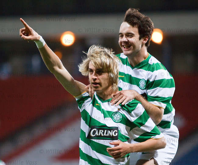Celtic's Filip Twardzik scores with a diving header to put Celtic 2-0 up and celebrates with Sean Fitzharris