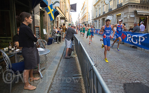 25 AUG 2013 - STOCKHOLM, SWE - Laurent Vidal (FRA) (second from the right) of France runs through the streets of Gamla Stan, the old part of Stockholm, Sweden, during the elite men's ITU 2013 World Triathlon Series round (PHOTO COPYRIGHT © 2013 NIGEL FARROW, ALL RIGHTS RESERVED)