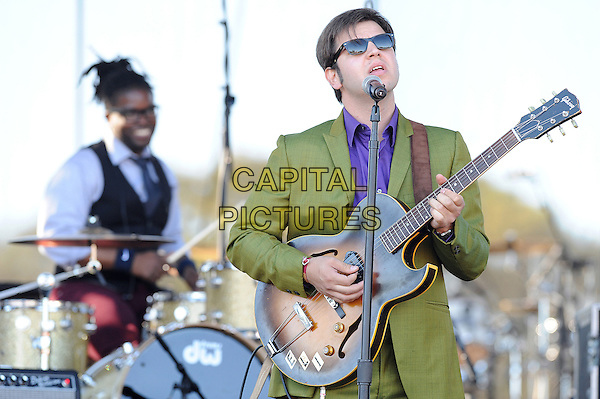 ELI PAPERBOY REED & THE TRU LOVES.performs live as part of the 2010 Voodoo Music Festival that is taking place at City Park, New Orleans, Louisian, USA, .29th October 2010..concert gig on stage half length green suit purple shirt sunglasses microphone singing playing guitar .CAP/ADM/MOO.© Moose/AdMedia/Capital Pictures.