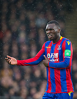 Christian Benteke of Crystal Palace holds his side after colliding with a advertising board during the Premier League match between Crystal Palace and Manchester City at Selhurst Park, London, England on 31 December 2017. Photo by Andy Rowland.