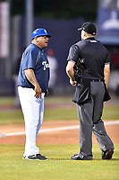 Asheville Tourists manager Robinson Cancel (37) discusses a reversed home run call with home plate umpire Tanner Moore during a game against the Delmarva Shorebirds at McCormick Field on May 4, 2019 in Asheville, North Carolina. The Shorebirds defeated the Tourists 4-0. (Tony Farlow/Four Seam Images)