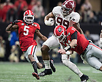Georgia Bulldogs quarterback Jake Fromm (11) makes the tackle on Alabama Crimson Tide defensive lineman Raekwon Davis (99) after Davis intercepted his pass in the third quarter of the NCAA College Football Playoff National Championship at Mercedes-Benz Stadium on January 8, 2018 in Atlanta. Photo by Mark Wallheiser/UPI