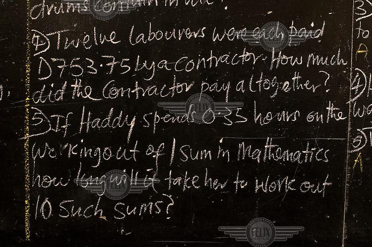 Maths problem written on the blackboard at Bakoteh lower basic school.