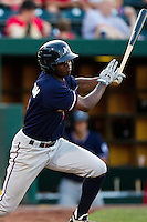 Derrick Robinson (9) of the Northwest Arkansas Naturals follows through his swing during a game against the Springfield Cardinals at Hammons Field on August 1, 2011 in Springfield, Missouri. Springfield defeated Northwest Arkansas 7-1. (David Welker / Four Seam Images)