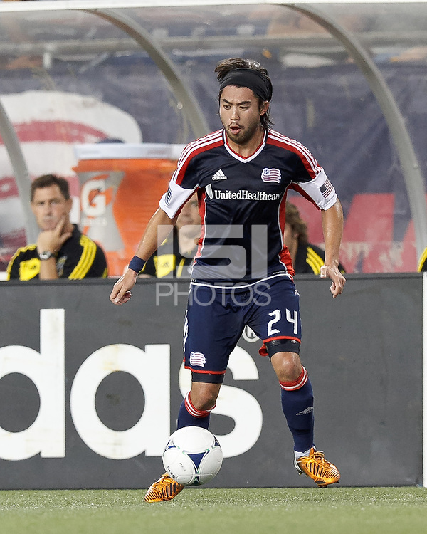 New England Revolution midfielder Lee Nguyen (24) collects a pass. In a Major League Soccer (MLS) match, the New England Revolution defeated Columbus Crew, 2-0, at Gillette Stadium on September 5, 2012.