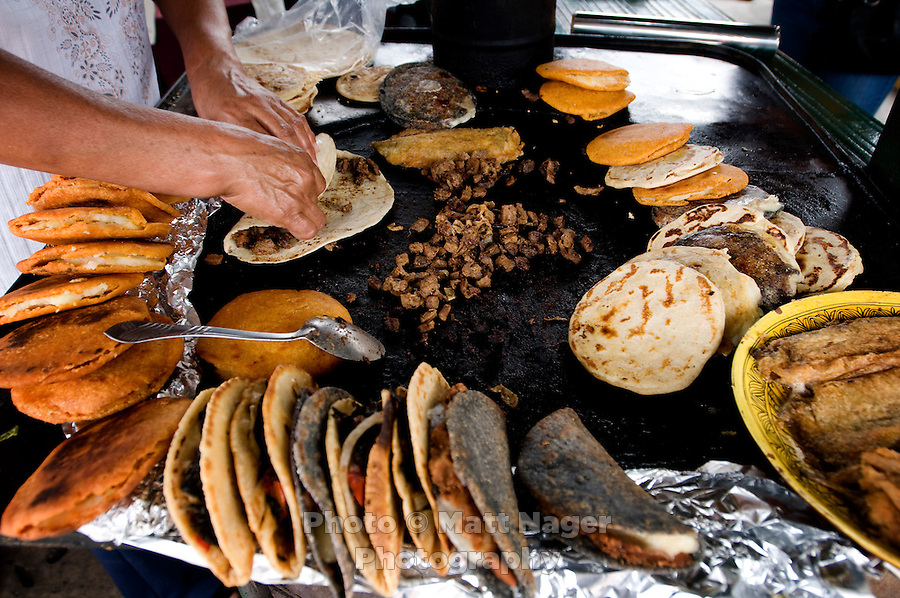 A woman prepares gorditas and chile rellenos next to the train stop in Divisadero, Mexico, Saturday, June 21, 2008...PHOTOS/ MATT NAGER