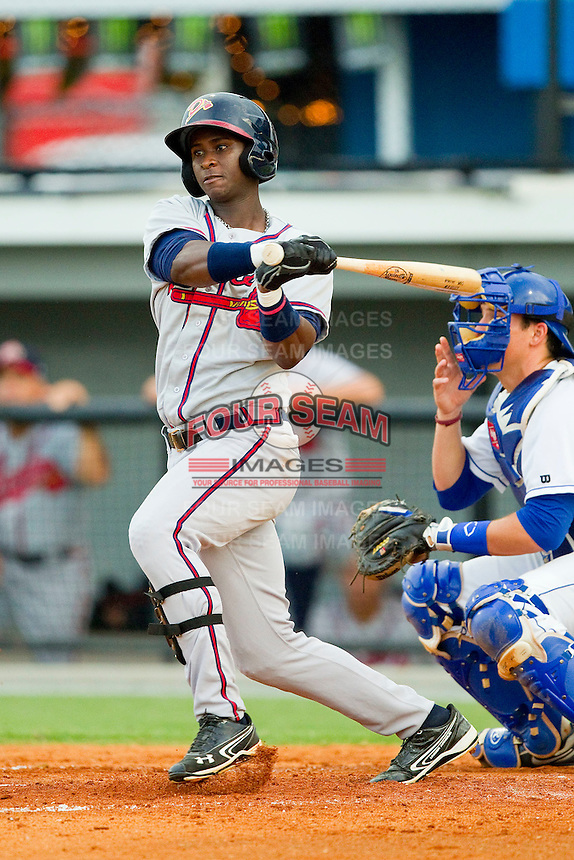 Felix Marte (5) of the Danville Braves follows through on his swing against the Burlington Royals at Burlington Athletic Park on July 19, 2012 in Burlington, North Carolina.  The Royals defeated the Braves 4-3.  (Brian Westerholt/Four Seam Images)