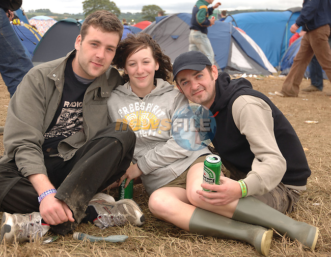 July 10th, 2006 Oxegen Music Festival. Day 2 Punchestown, County Kildare..Photographed enjoying the above from L to R: Jonathan Gileen (Galway), Stacey Swain (Canada) and Paul Mellie (Donegal)..Photo: BARRY CRONIN/Newsfile..(Photo credit should read BARRY CRONIN/NEWSFILE).