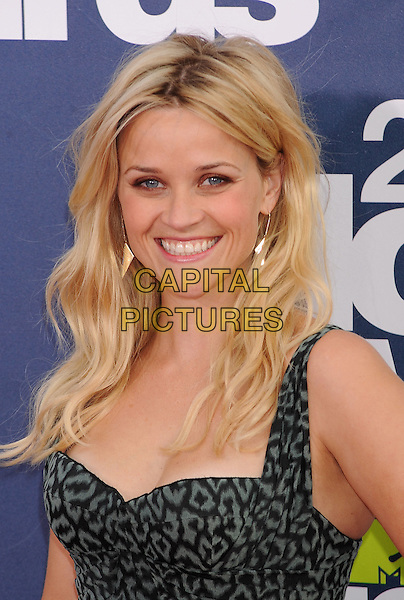 Reese Witherspoon.The 2011 MTV Movie Awards held at Universal Studios Gibson Amphitheatre, Universal City, California, USA..June 5th, 2011.headshot portrait green grey gray black print dangling gold earrings smiling.CAP/ROT/TM.©Tony Michaels/Roth Stock/Capital Pictures