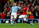Kyle Walker of Manchester City tackled by Fred of Manchester United during the Carabao Cup match at Old Trafford, Manchester. Picture date: 7th January 2020. Picture credit should read: Darren Staples/Sportimage