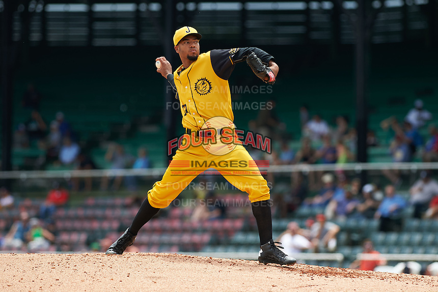 Jacksonville Suns pitcher Kendry Flores (12) delivers a pitch during the 20th Annual Rickwood Classic Game against the Birmingham Barons on May 27, 2015 at Rickwood Field in Birmingham, Alabama.  Jacksonville defeated Birmingham by the score of 8-2 at the countries oldest ballpark, Rickwood opened in 1910 and has been most notably the home of the Birmingham Barons of the Southern League and Birmingham Black Barons of the Negro League.  (Mike Janes/Four Seam Images)