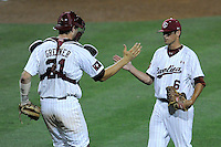 Catcher Grayson Greiner (21) congratulates closer Joel Seddon (6) of the South Carolina Gamecocks after the final out in an NCAA Division I Baseball Regional Tournament game against the Campbell Camels on Friday, May 30, 2014, at Carolina Stadium in Columbia, South Carolina. South Carolina won, 5-2. (Tom Priddy/Four Seam Images)