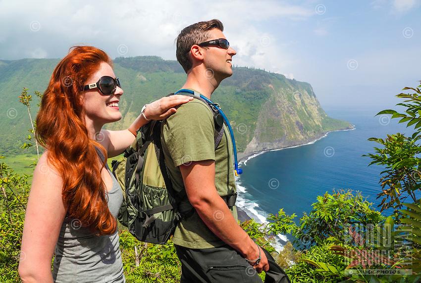 Hikers enjoy sea views from an overlook along the road into Waipi'o Valley, Big Island of Hawai'i.