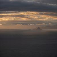 Midnight sunset over distant islands of Vesterålen from Gimsøy, Lofoten Islands, Norway