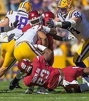 NWA Democrat-Gazette/BEN GOFF @NWABENGOFF<br /> Dre Greenlaw and De'Jon Harris, Arkansas linebacker, tackle Derrius Guice, LSU running back, as Will Clapp (64), LSU center, blocks in the first quarter Saturday, Nov. 11, 2017 at Tiger Stadium in Baton Rouge, La.
