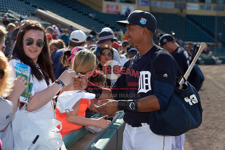 Detroit Tigers shortstop Dixon Machado (49) signs autographs after an exhibition game against the Florida Southern Moccasins on February 29, 2016 at Joker Marchant Stadium in Lakeland, Florida.  Detroit defeated Florida Southern 7-2.  (Mike Janes/Four Seam Images)