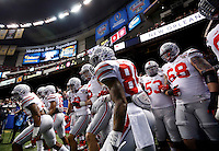 The Ohio State Buckeyes take the field prior to the Allstate Sugar Bowl college football playoff semifinal against the Alabama Crimson Tide at the Mercedes-Benz Superdome in New Orleans on Jan. 1, 2015. (Adam Cairns / The Columbus Dispatch)