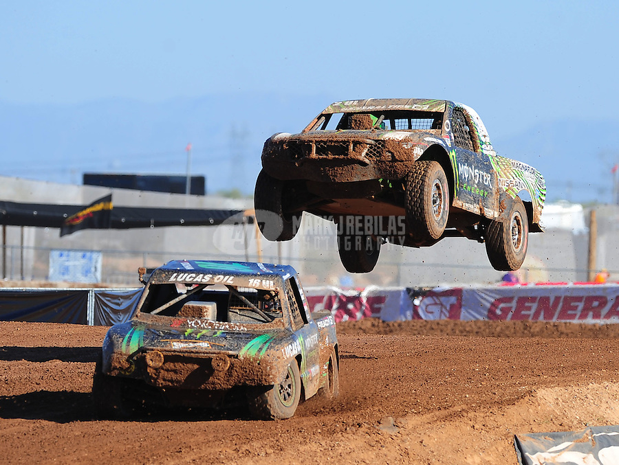 Apr 16, 2011; Surprise, AZ USA; LOORRS driver Cameron Steele (16) leads Casey Currie (2) during round 3 at Speedworld Off Road Park. Mandatory Credit: Mark J. Rebilas-.