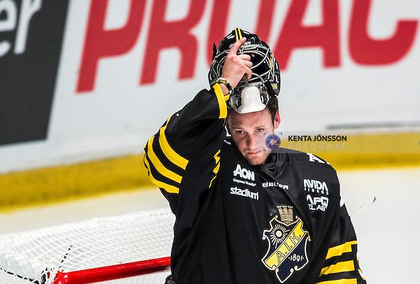 Stockholm 2014-09-11 Ishockey Hockeyallsvenskan AIK - S&ouml;dert&auml;lje SK :  <br /> AIK:s m&aring;lvakt Alexander Hamberg ser nedst&auml;md ut<br /> (Foto: Kenta J&ouml;nsson) Nyckelord:  AIK Gnaget Hockeyallsvenskan Allsvenskan Hovet Johanneshovs Isstadion S&ouml;dert&auml;lje SK SSK depp besviken besvikelse sorg ledsen deppig nedst&auml;md uppgiven sad disappointment disappointed dejected
