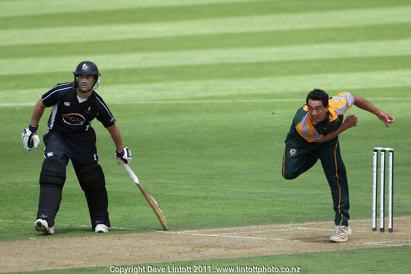 Naenae's Robert Karaitiana bowls during the Wilkinson Pearce Cup Wellington club cricket Twenty20 final, HRV  Karori v Naenae Old Boys at Hawkins Basin Reserve, Wellington, New Zealand on Wednesday, 11 January 2012. Photo: Dave Lintott / lintottphoto.co.nz