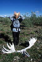 The sun-bleached skull and antlers of a moose inspire antler antics along the banks of the Sanctuary River in Denali National Park, Alaska.