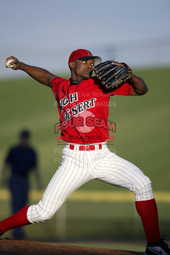 George Perez of the High Desert Mavericks pitches during a California League 2002 season game at Mavericks Stadium, in Adelanto, California. (Larry Goren/Four Seam Images)