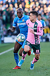 Allan-Romeo Nyom of Getafe FC and Alex Moreno of Real Betis Balompie during La Liga match between Getafe CF and Real Betis Balompie at Wanda Metropolitano Stadium in Madrid, Spain. January 26, 2020. (ALTERPHOTOS/A. Perez Meca)