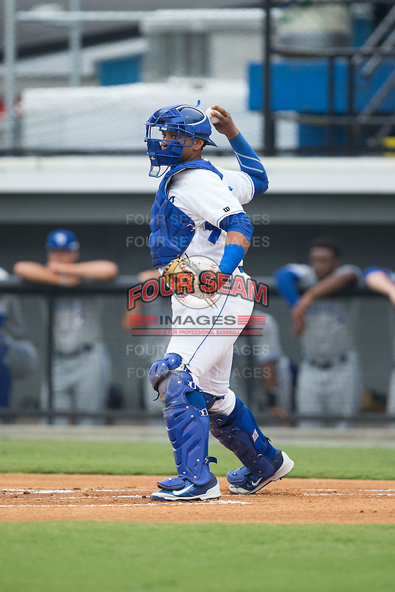 Burlington Royals catcher Xavier Fernandez (34) makes a throw to third base following a strike out in the game against the Bluefield Blue Jays at Burlington Athletic Park on July 1, 2015 in Burlington, North Carolina.  The Royals defeated the Blue Jays 5-4. (Brian Westerholt/Four Seam Images)