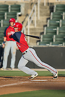 Cody Dent (4) of the Hagerstown Suns follows through on his swing against the Kannapolis Intimidators at CMC-Northeast Stadium on June 16, 2015 in Kannapolis, North Carolina.  The Suns defeated the Intimidators 8-4.  (Brian Westerholt/Four Seam Images)
