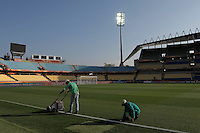 Groundsmen prepare the pitch prior to the game between England and USA. USA vs England in the 2010 FIFA World Cup in Rustenburg, South Africa on June 12, 2010.