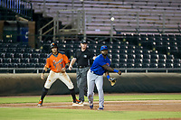 AZL Cubs third baseman Delvin Zinn (21) makes a throw to first base after holding Diego Rincones (35) on base during Game Three of the Arizona League Championship Series against the AZL Giants on September 7, 2017 at Scottsdale Stadium in Scottsdale, Arizona. AZL Cubs defeated the AZL Giants 13-3 to win the series two games to one. (Zachary Lucy/Four Seam Images)