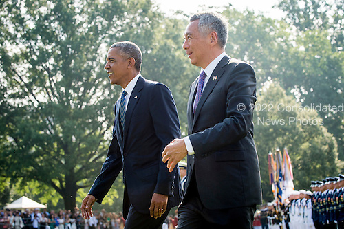 United States President Barack Obama and Prime Minister Lee Hsien Loong of Singapore make their way to greet guests during official welcoming ceremonies on the South Lawn of the White House in Washington, DC on August 2, 2016. Lee is on a State Visit to the United States.  <br /> Credit: Pete Marovich / Pool via CNP