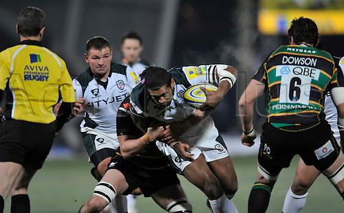 26.11.10.  Chris Halaufia of London Irish gets tackled. Aviva Premiership Rugby Round 9 Northampton Saints vs London Irish at Franklins Gardens, Northampton, England