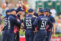 England's Chris Woakes celebrates the wicket of New Zealand's Colin Munro, Black Caps v England, second international cricket ODI, Bay Oval, Tauranga, New Zealand. Wednesday, 28 February, 2018. Copyright photo: John Cowpland / www.photosport.nz