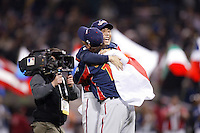 Koji Uehara and Naoyuki Shimizu of Japan during World Baseball Championship at Petco Park in San Diego,California on March 20, 2006. Photo by Larry Goren/Four Seam Images