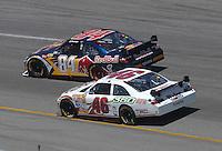 May 6, 2007; Richmond, VA, USA; Nascar Nextel Cup Series driver A.J. Allmendinger (84) races alongside Johnny Benson (46) during the Jim Stewart 400 at Richmond International Raceway. Mandatory Credit: Mark J. Rebilas