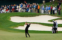 PGA golfer Luke Donald hits from the fairway as the crowd looks on during the 2007 Wachovia Championships at Quail Hollow Country Club in Charlotte, NC.