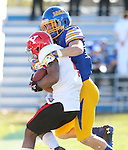 BROOKINGS, SD - OCTOBER 25:  Jimmie Forsythe #25 from South Dakota State University brings down Andre Stubbs #4 from Youngstown State in the first quarter of their game Saturday afternoon at Coughlin Alumni Stadium in Brookings. (Photo by Dave Eggen/Inertia)