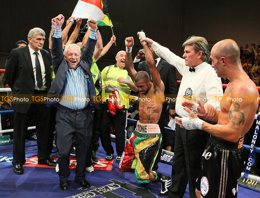 Rendall Munroe (multicololoured shorts, the Boxing Binman) defeats Simone Maludrottu in a Super-Bantamweight boxing contest for the European EBU Title at the Harvey Hadden Leisure Centre, Nottingham, promoted by Frank Maloney - 20/11/09 - MANDATORY CREDIT: Gavin Ellis/TGSPHOTO - Self billing applies where appropriate - Tel: 0845 094 6026