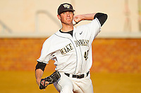 Starting pitcher Brian Holmes #45 of the Wake Forest Demon Deacons warms up in the bullpen prior to the game against the Charlotte 49ers at Gene Hooks Field on March 22, 2011 in Winston-Salem, North Carolina.   Photo by Brian Westerholt / Four Seam Images