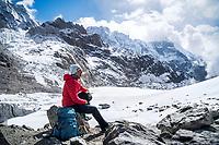 A woman trekker on Cho La Pass, part of the 3 Passes Tour around the Khumbu Valley, Nepal